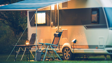 Camper with Awning and 2 camper chairs